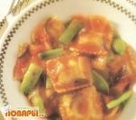 Равиоли в соусе из зелени и томатов